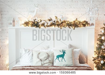 Burning lantern and christmas decoration on white background. Xmas tree. Candleholder house. Bed with pillow.