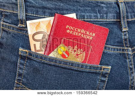 MOSCOW RUSSIA - NOVEMBER 27 2016: Russian passport banknote 50 euro and credit card MasterCard in back jeans pocket. Travel concept