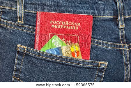 MOSCOW RUSSIA - NOVEMBER 27 2016: Russian passport and credit cards in back jeans pocket. Travel concept