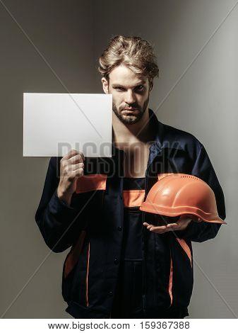 Serious Man Keeps Hard Hat