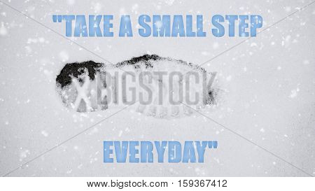 shoeprint in the snow with quote