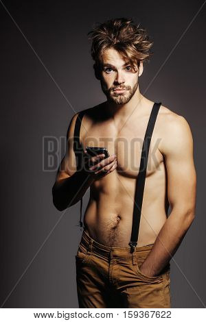Handsome Man Holds Smartphone