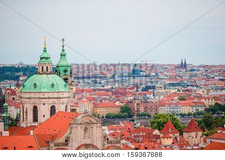 Aerial view of ancient building with red roofs in Praga
