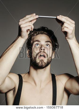 Surprised Man Looks At Smartphone