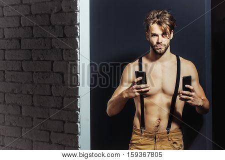 Handsome Man With Two Smartphones