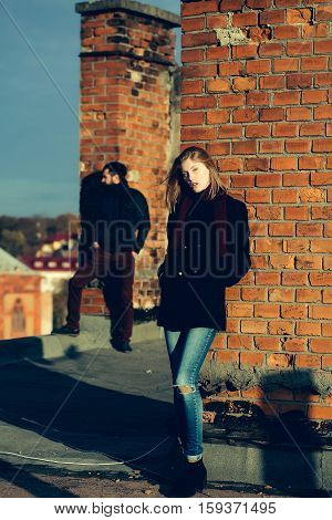 Girl And Man On Roof