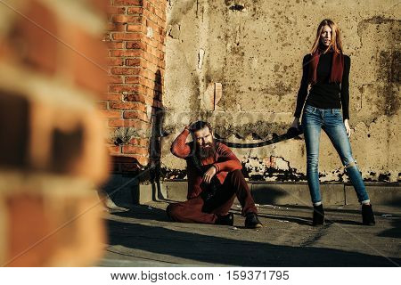 Young Couple Near Roof Brick Wall