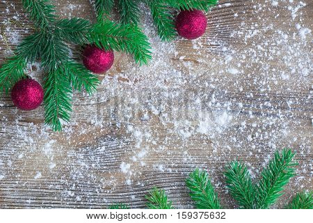 Christmas Tree Green Branches, Red Balls, Winter Snowbound Wooden Background