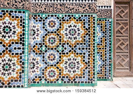 MARRAKECH MOROCCO - APR 29 2016: Mosaic detail in the inner court of the historical Ben Youssef Madrasa. A former Islamic college in Marrakech Morocco.