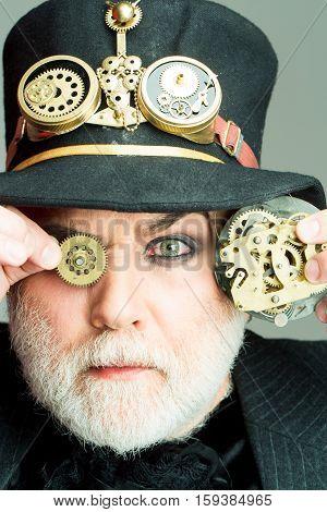 Man Keeps Cogwheel And Gears