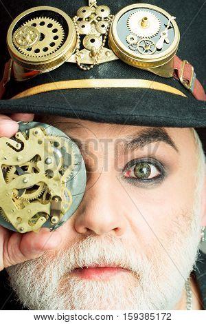 Bearded Man Looks Through Gear