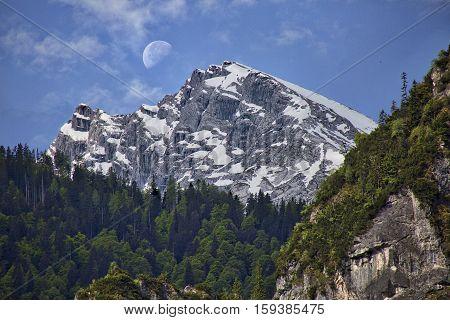 Watzmann peak with moon over the top. Near Berchtesgaden, Germany. Taken from Schoenau am Koenigssee
