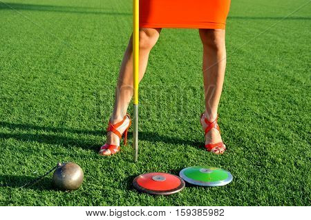Discus, Javelin And Hammer Girl With Stilettos