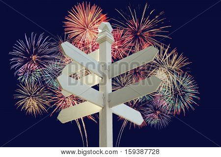 direction sign with blank spaces for text with celebrate firework background