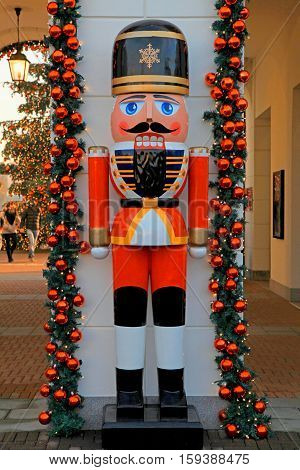 Soldier nutcracker statue and Christmas tree decoration on the street