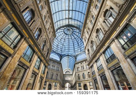 NAPLES ITALY- AUGUST 19 2013: Shopping gallery Galleria Umberto in Naples Italy. Naples historic city center is the largest in Europe and is listed by UNESCO as a World Heritage Site.