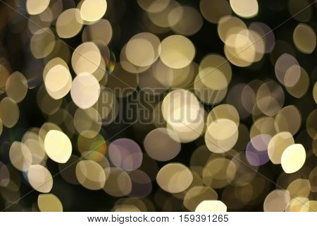 Abstract background with yellow bokeh light for happy new year day christmas and other events