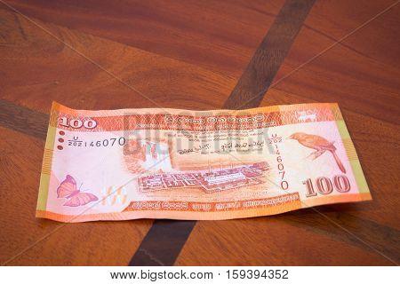 One Hundred Rupees.