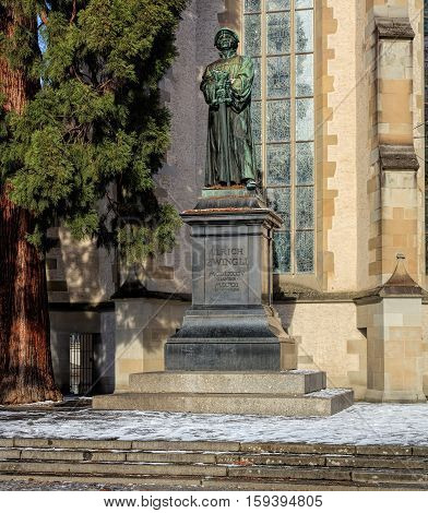 Zurich, Switzerland - 18 January, 2016: statue of Ulrich Zwingli at the Water Church. The bronze statue by sculptor Heinrich Natter was unveiled in 1885.