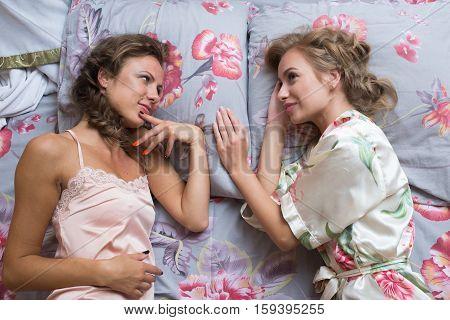 Two sexy young women in bed. beautiful gentle girlfriend