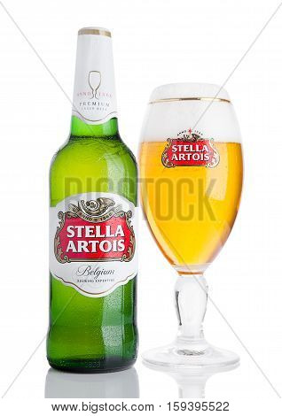LONDON UK -NOVEMBER 29. 2016 Cold Bottle and glass of Stella Artois beer on white background prominent brand of Anheuser-Busch InBev is a pilsner brewed in Leuven Belgium since 1926