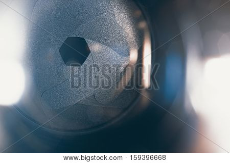 Lens front side exposed aperture blades. Aperture blade of camera lens