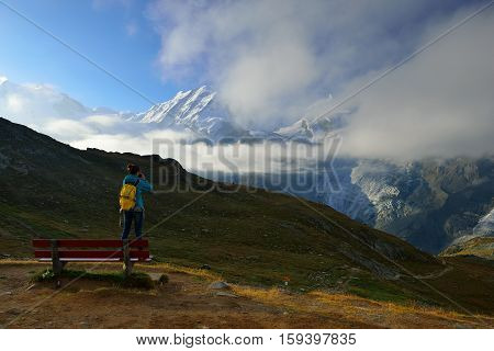 The woman hiker are looking from Rotenboden station to mountain view in summer Zermatt Switzerland