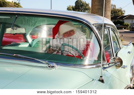 Santa Claus arrives in style in his Classic Car. Santa loves to deliver presents in his car when his Reindeer are tired. Santa Drives