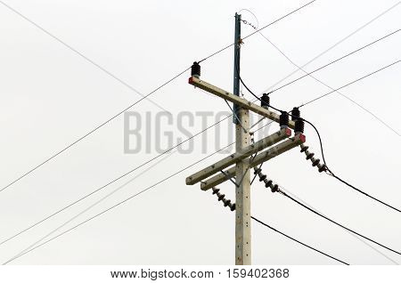 High voltage pole. Pole and high voltage transmission lines outdoors.