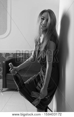 Happy Girl With Champagne And Flute In Black And White