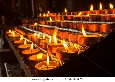 Group Of Votive Candle In A Church