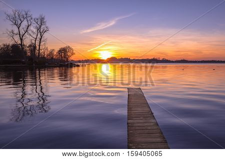 Tranquil Purple Sunset Over Serene Lake
