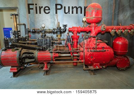 Toronto city, Ontario, Canada, May 22, 2016, closeup view of beautiful detailed old vintage machine tool fire pump at Toronto distillery district art gallery on art fest day