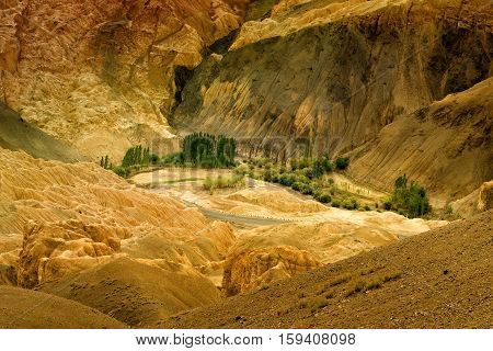 Yellow colourful rocks and stones - formation like moon surface on earth place called moonland mountains ladakh landscape Leh Jammu Kashmir India