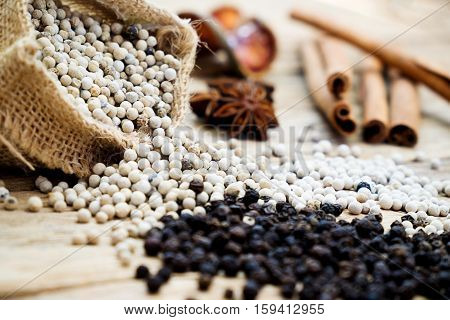 Spices and herbs for cooking background. Group of spices on wooden background and selective focus.