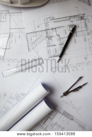 Desk of Engineering project in construction site or office. Construction concept.Engineering tools.Vintage tone retro filter effectsoft focus(selective focus)