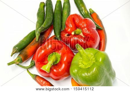 Red and Green peppers isolated on white background