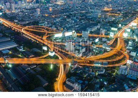 Bangkok highway intersection aerial view night time, long exposure