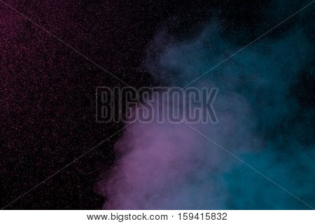 Abstract blue purple water vapor on a black background. Texture. Design elements. Abstract art. Steam the humidifier. Macro shot.
