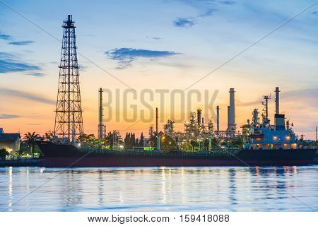 Sunrise over oil refinery river front, industrial landscape background