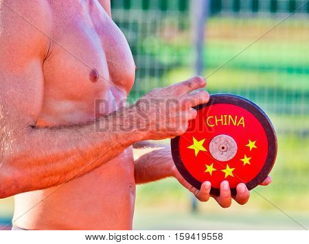 Chinese Athlete Preparing To Throw The Disc