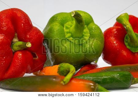 Red Green and Yellow peppers isolated on white background