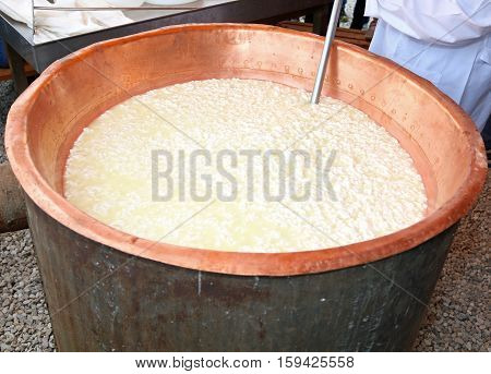 Cauldron With The Curdled Milk To Make Cheese