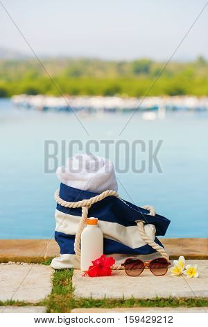 Beach Bag, Towel, Sunscreen And Sunglasses