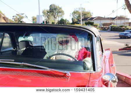Santa Claus drives his Hot Rod Car.