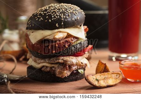 Trendy Burger With Four Meats In Black Bun