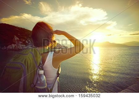A traveller looking at sunset on the islands. Traveling along Asia active lifestyle concept