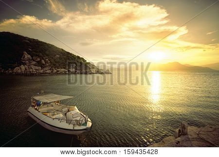 Speedboat on the beach at sunset time. Beautiful natural seascape