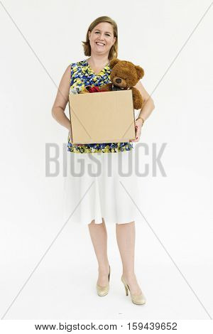 Woman carrying a box of items for donation