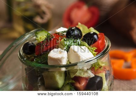 Greek Salad Served In Glass Jar With Ingredients